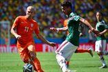 Нидерланды драматично проходят Мексику