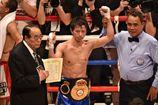 Тагучи бьет Ландаэту и защищает титул